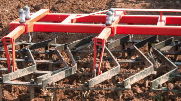 Spring loaded tine sections, drawbars, drag chains