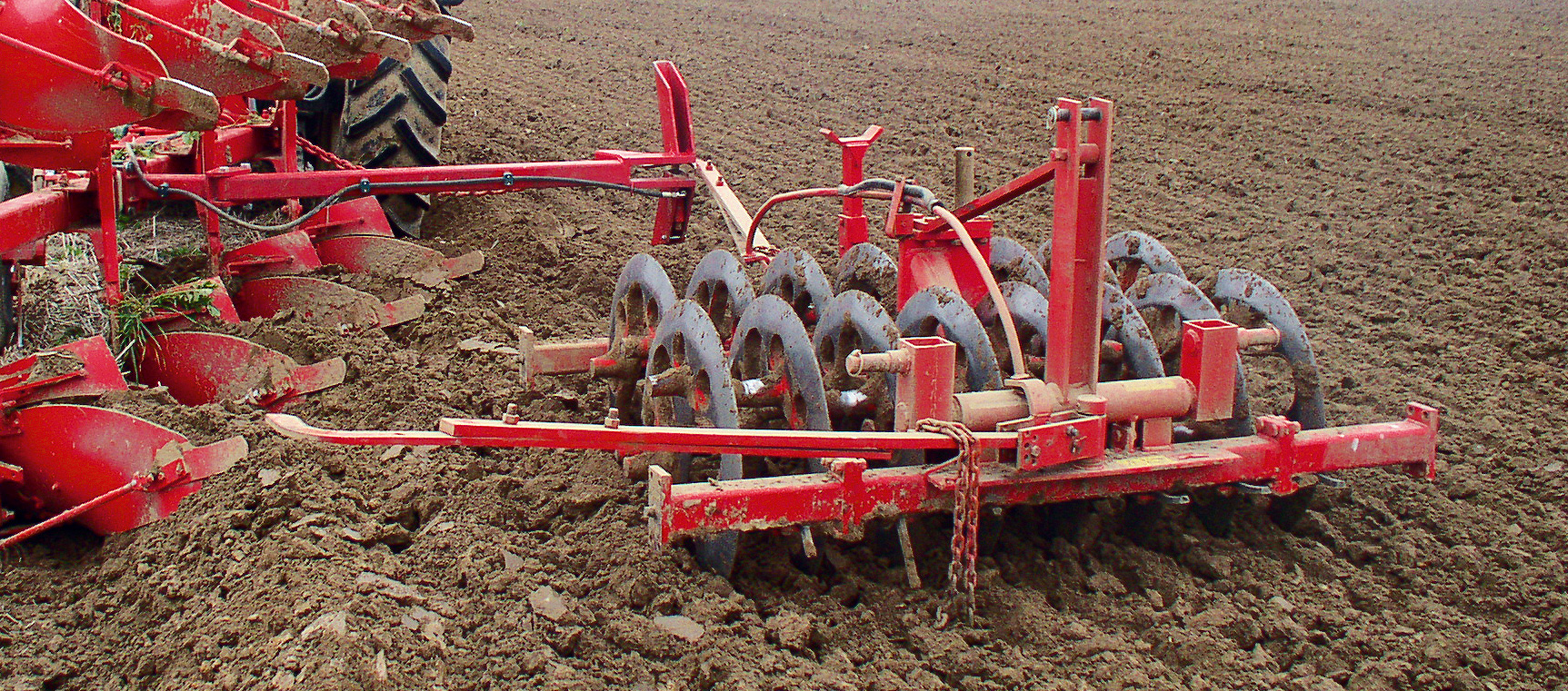 Furrow press for ploughs